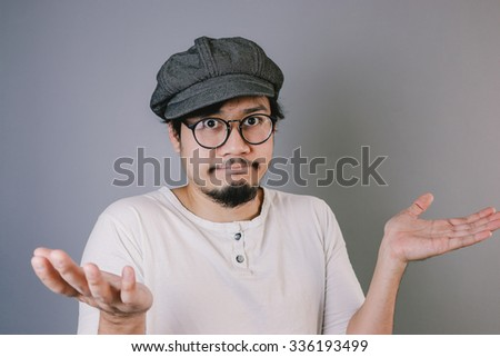 Asian man dont know or not sure. - stock photo