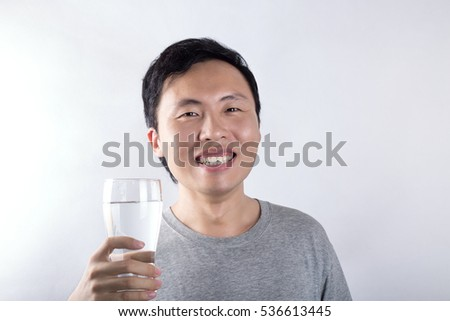Asian man drinking water