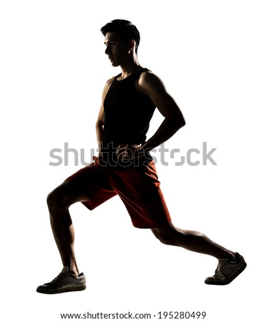 Asian man exercising fitness workout lunges crouching in silhouette on white background. - stock photo