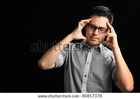 Asian man having a headache - stock photo