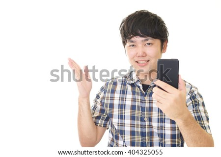 Asian man holding a smart phone