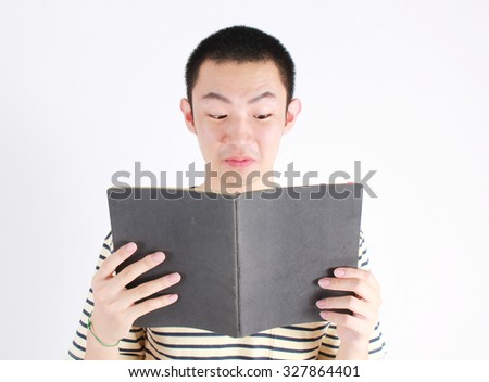 Asian man holding the book.