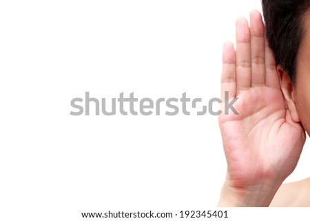 Asian man holds his hand near his ear and listening - stock photo
