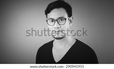 Asian man in black and white.