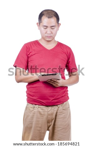 asian man in red shirt playing tablet