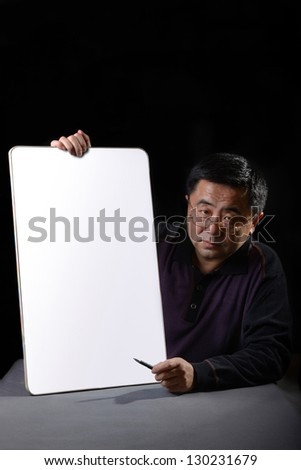 Asian man introduce something with blank board. - stock photo