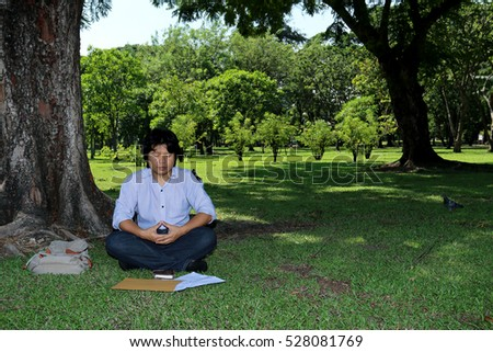 Asian man is doing meditation in the park