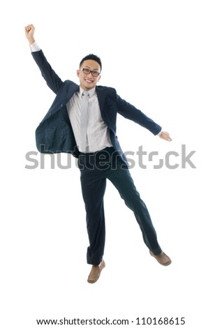 asian man jumping in joy - stock photo
