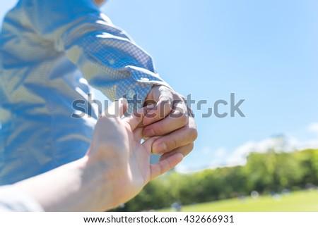 Asian man leading her girlfriend - stock photo