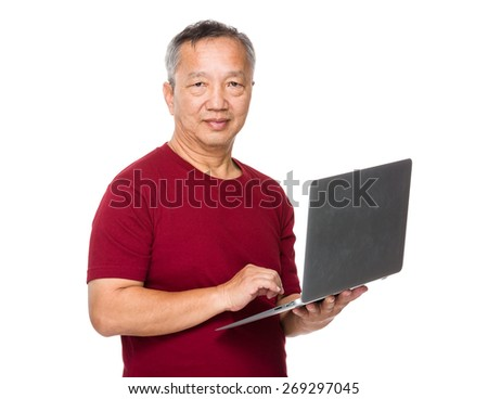 Asian man learn to use of laptop - stock photo