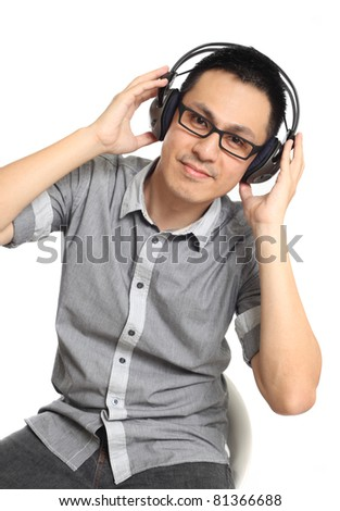 Asian man listening to music. Isolated on white background.