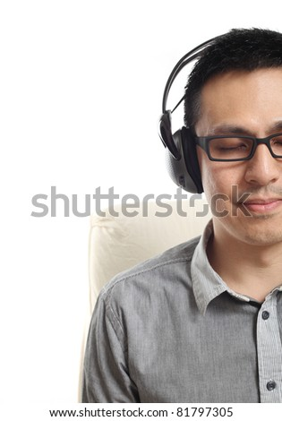 Asian man listening to music. Isolated on white background. - stock photo