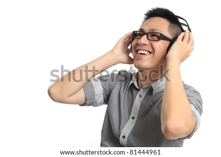 Asian man listening to music with cheerful face. Isolated on white background.