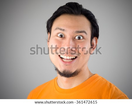 Asian man make evil smile face. - stock photo