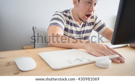 Asian man on his work. Asian freelance man is feeling excited. - stock photo