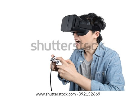 Asian man playing game with VR glasses