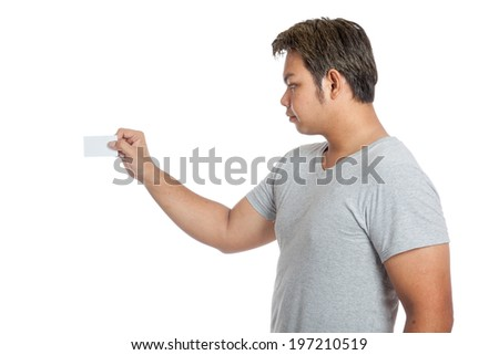 Asian man put a blank card to something isolated on white background