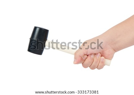Asian man's hand holding a wooden rubber mallet, isolated on white