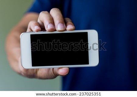 asian man show his smart phone