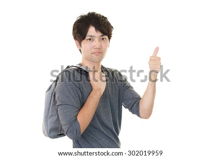 Asian man showing thumbs up sign