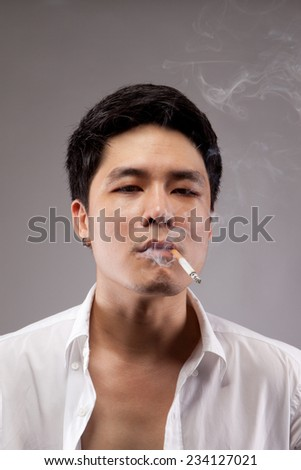 Asian man smoking.