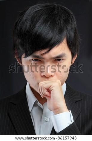 asian man thinking - stock photo
