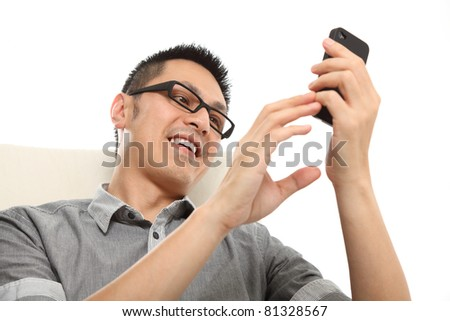 Asian man typing a message on mobile phone. Isolated on white background. - stock photo