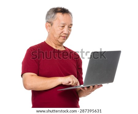 Asian man use of laptop computer