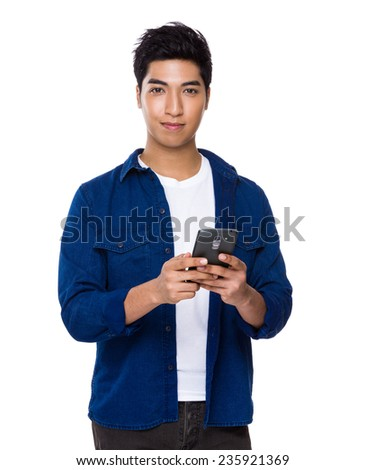 Asian man use of mobile phone