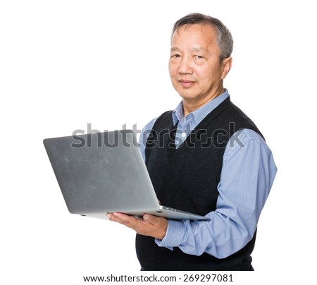 Asian man use of notebook computer - stock photo