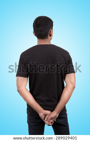 Asian man wearing blank black t-shirt isolated on blue sky background - stock photo