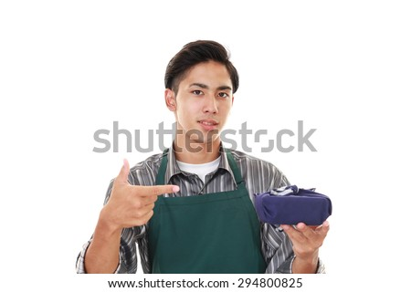 Asian man wearing kitchen apron