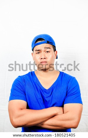 Asian man with an offended expression.