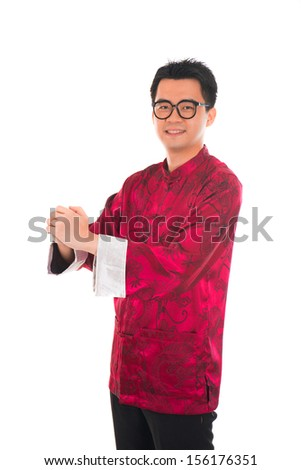 Asian man with Chinese traditional dress cheongsam and gong xi fa cai greetings - stock photo