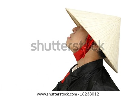 Asian man with conical hat looking upwards sideview