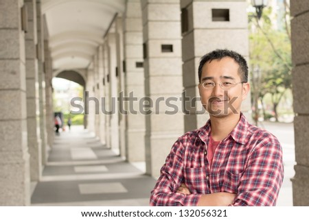 Asian man with glasses stand at street, closeup portrait. - stock photo