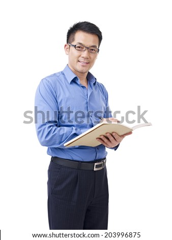 asian man with pen and notebook, isolated on white. - stock photo