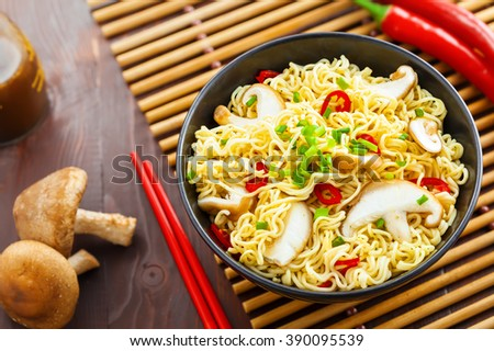 Asian meal made of instant noodles and shiitake mushrooms, traditional oriental food, top view - stock photo