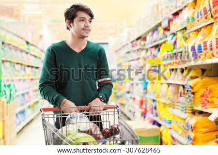 Asian men are choosing to buy in the supermarket - stock photo