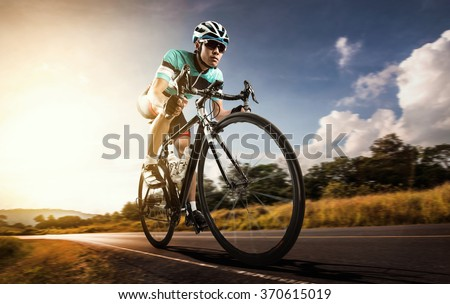 Asian men are cycling road bike in the morning - stock photo