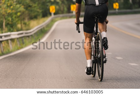 Asian men are cycling road bike morning uphill on the road with soft tone