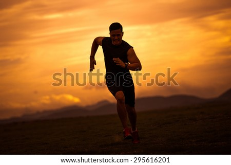 Asian men are siluate jogging at a speed in the evening - stock photo