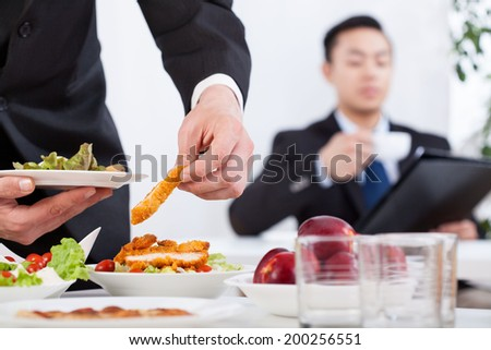 Asian men during business lunch in the office - stock photo