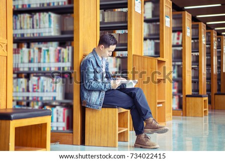 Asian men reading in the library