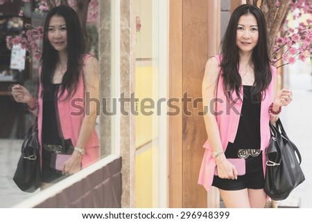 Asian middle age business woman walking outdoor - stock photo