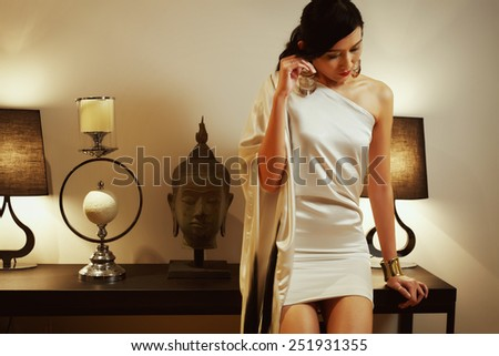 Asian model in luxxury room with evenig ambient light - stock photo