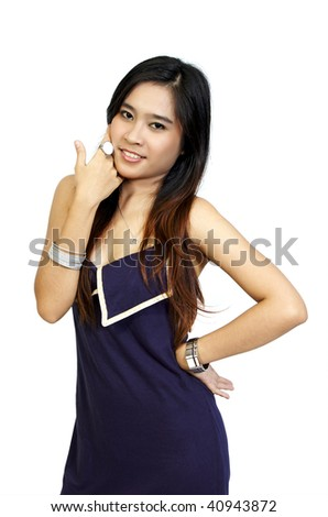 Asian Model Posing at white background. She looks pretty and fresh. She wearing blue dress