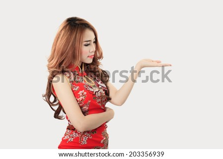 Asian model wearing Cheongsam with copy space for product or text - stock photo