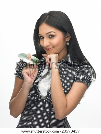 Asian modern teenage girl with the cd - stock photo