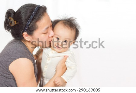 Asian mom holding baby in white background - stock photo
